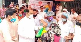 স্বপ্ন সিরাজগঞ্জ শাখার উদ্যোগে খাদ্যসামগ্রী বিতরণ করেন এমপি আজিজ